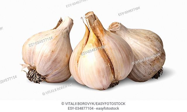Three bulbs of garlic beside isolated on white background