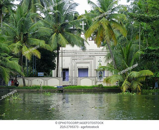 Landscape with coconut trees and chapel. Backwaters of Kerala, India