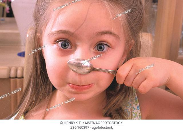 Funny girl with spoon