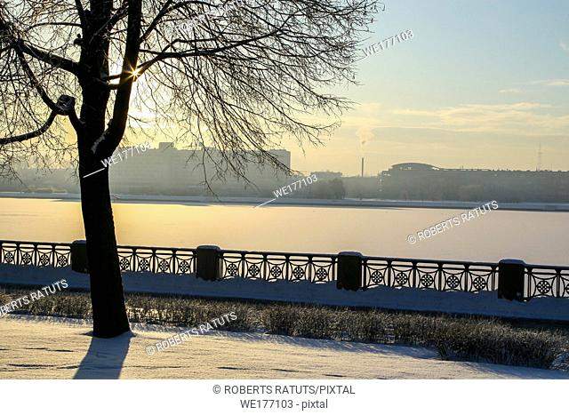 View of Riga from the 11th November Embankment side. Riga view in winter. Frozen river Daugava at the 11th November Embankment
