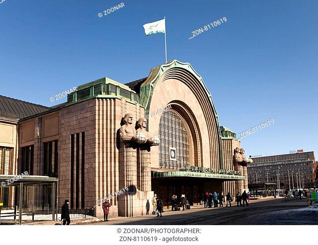 HELSINKI, FINLAND - MARCH 17, 2013: Helsinki central railway station, facade and main entrance on march 17, 2013 in Helsinki, Finland