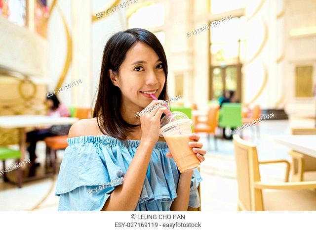 Woman having fruit juice