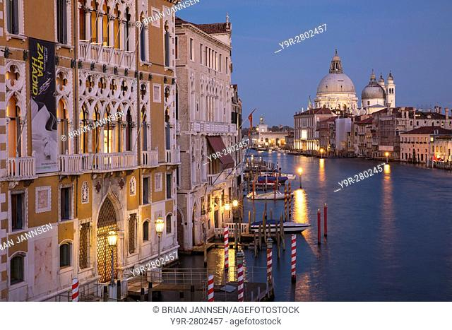 Twilgiht over the buildings along the Grand Canal with Santa Maria della Salute beyond, Venice, Veneto, Italy