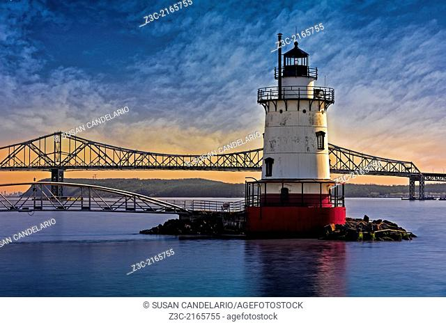 The Tarrytown Lighthouse also know as the Sleepy Hollow Light and Kingsland Point Light during sunset with the Tappan Zee Bridge in the background