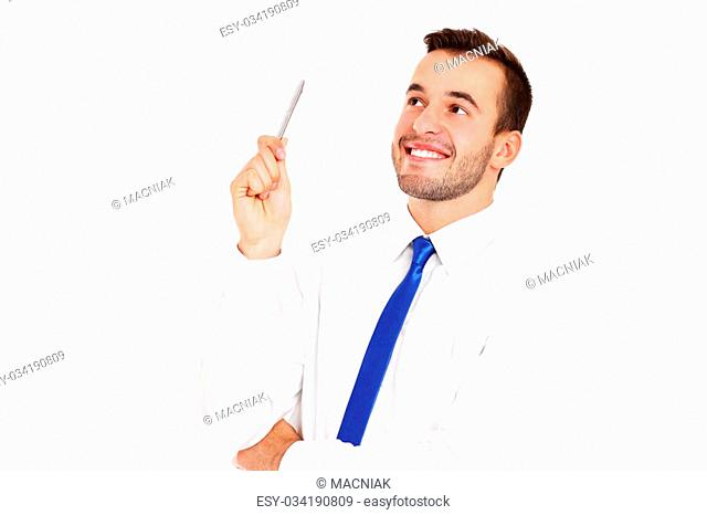 A picture of a successful businessman posing with a pen over white background
