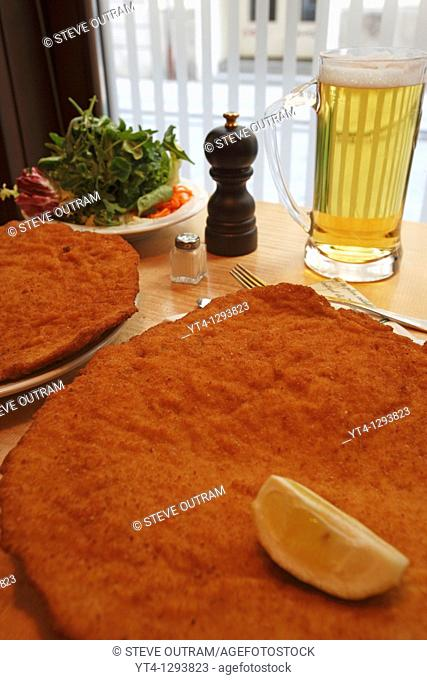 Austrian Cuisine  Wiener Schnitzel, Figmuller Restaurant, Vienna, Austria  The restaurant claims to have the biggest schnitzel in the world