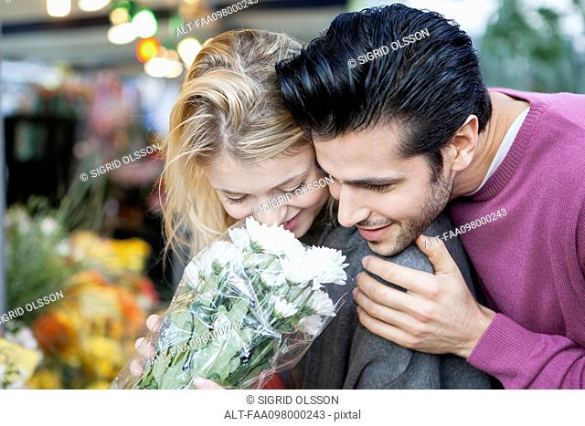 Young couple with flower bouquet