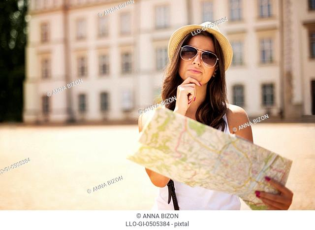 Tourist girl with map wondering where she should go, Debica, Poland