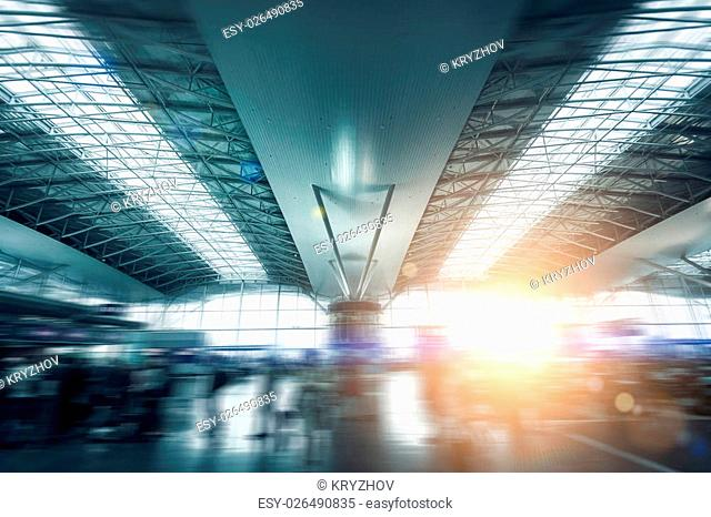 Photo of modern international airport terminal lit by sun light