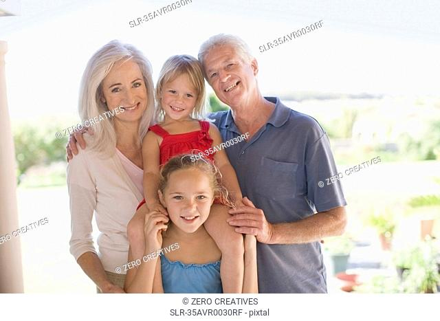 Grandparents and grandchildren smiling