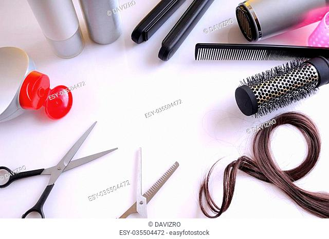 Set hairdressing articles exposed on a white table with room in the center for writing top view isolated