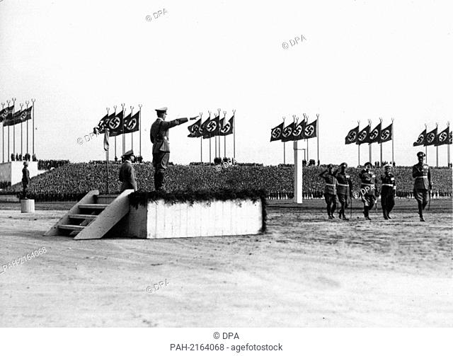 On Wehrmacht Day on Nuremberg Zeppelinfeld, General Field Marshal Werner von Blomberg (r) opens the parade past Adolf Hitler (l, on the platform)