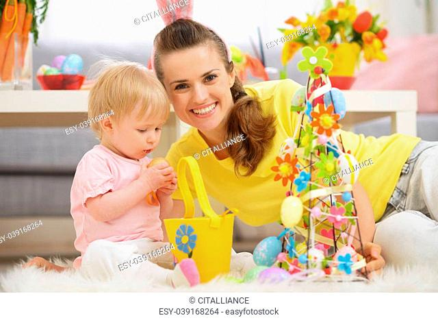 Baby and mother spending time together on Easter