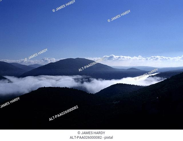 France, Alpes, mountain top surrounded by clouds