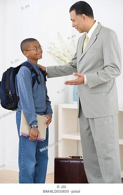African father seeing son off to school
