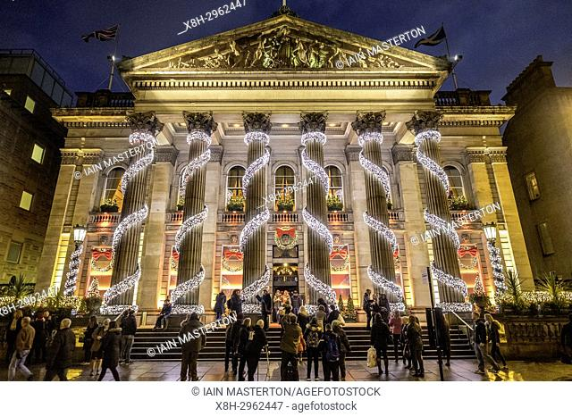 Exterior night view of The Dome restaurant on George Street with Christmas decorations in Edinburgh New Town, Scotland, United Kingdom