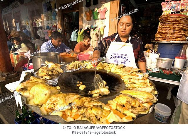 Food stalls under  the arcades of the ' plaza chica'. Pátzcuaro. Michoacán State. Mexico