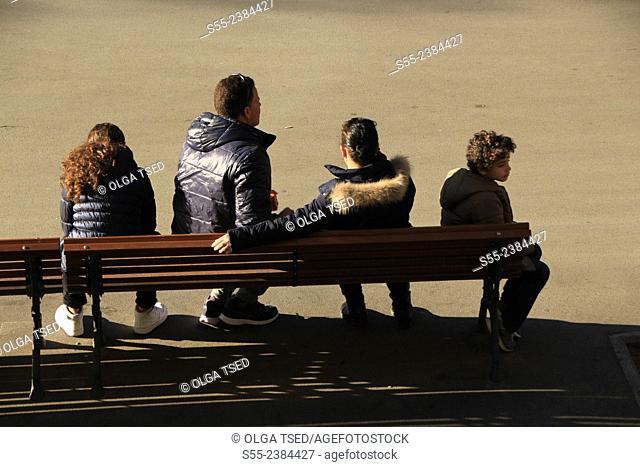 Tourists resting on the bench. Rambla Catalunya, Barcelona, Catalonia, Spain