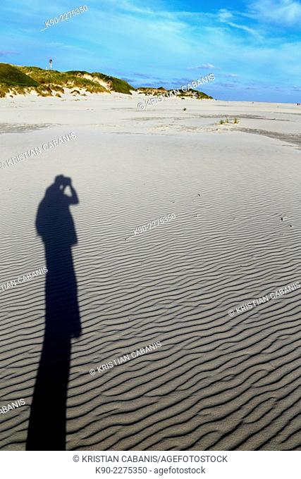 Shadow of a photograhper on the sand, Amrum, North Frisian islands, Schleswig-Holstein, Germany, Europe