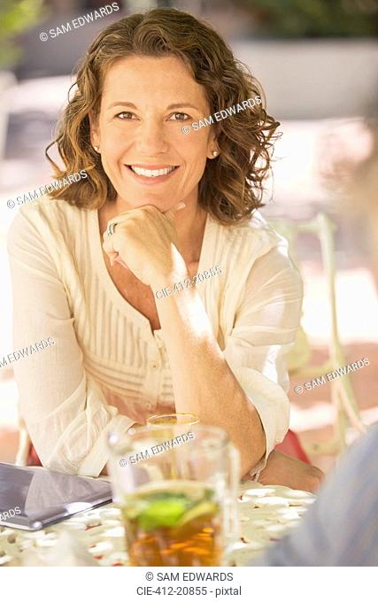 Older woman sitting at outdoor table