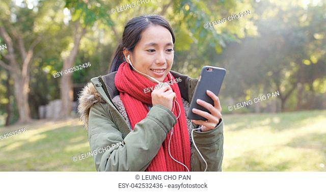 Woman making live stream at outdoor park