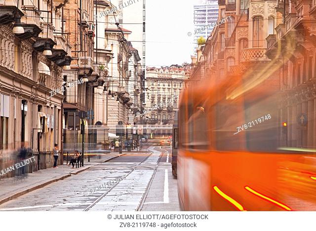 A tram rushes down a street in Turin, Italy