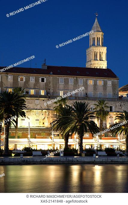 Split Harbor, the Riva (foreground) and Cathedral of St Domnius Tower (background) at sunset, Split, Croatia