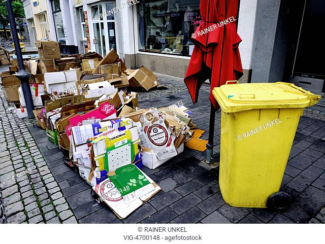 DEU , GERMANY : Recycling paper and a Yellow Can are waiting for collection in Bonn - Bonn, Northrhine-, Germany, 05/08/2014