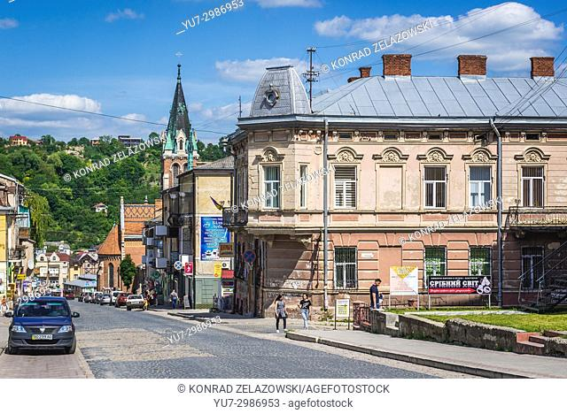 Stepan Bandera street in Chortkiv city in Ternopil Oblast of western Ukraine. Bell tower of Saint Stanislaus Church on background