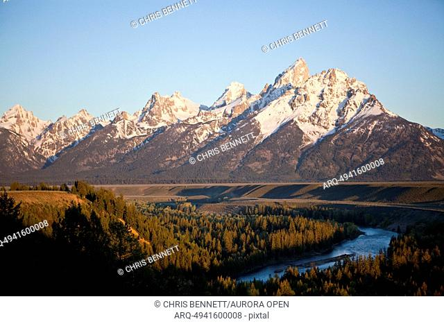 The Tetons loom over the Snake River and the valley of Jackson Hole, Wyoming