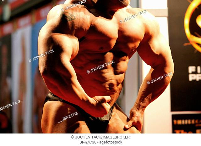 DEU, Germany, Essen : FIBO, Fitness and leisure exhibition. Muscle show of a bodybuilder
