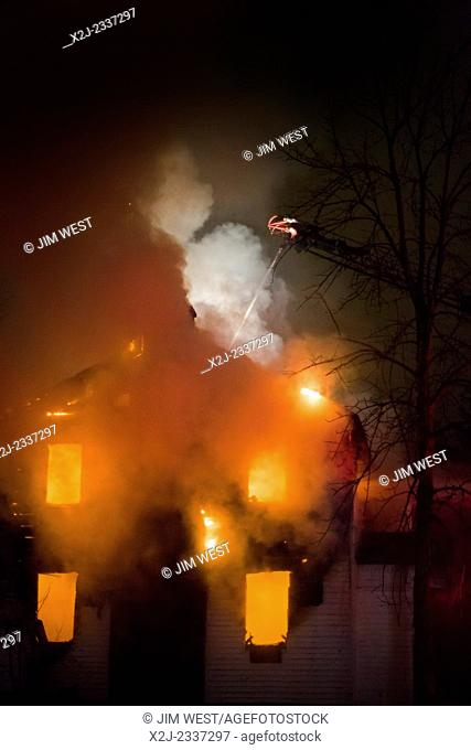 Detroit, Michigan - Firefighters battle a fire which destroyed a vacant home in Detroit's Morningside neighborhood. The city has tens of thousands of vacant...