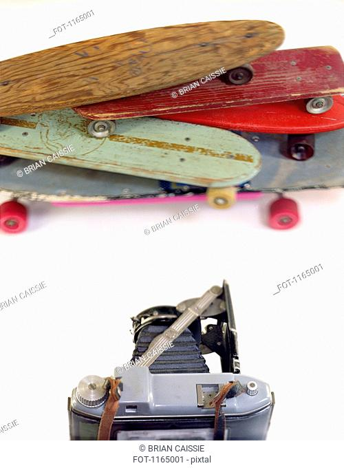 A large format camera and skateboards in a photo studio