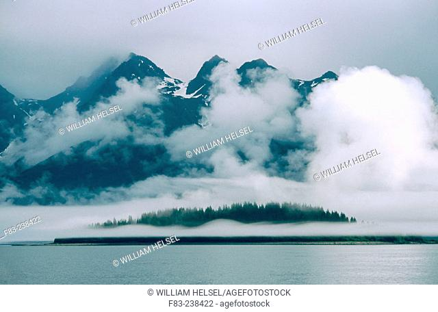 Clouds over the mountains. Glacier Bay. Glacier Bay National Park. Alaska. USA