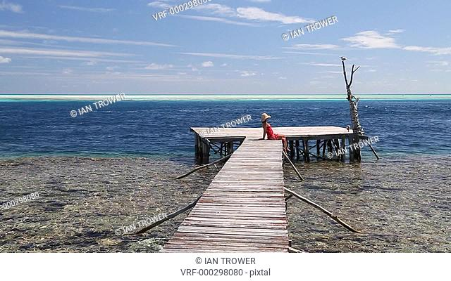 Woman walking on pier, Tetamanu, Fakarava, Tuamotu Islands, French Polynesia