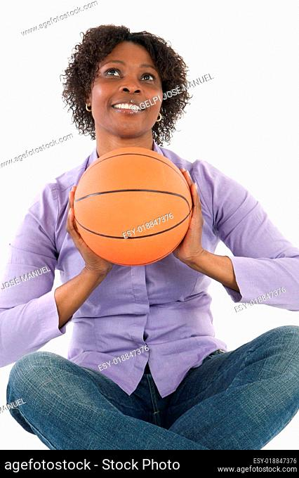 Woman with balloon of basketball