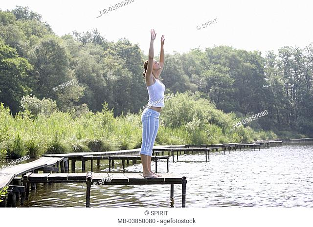 Woman, young, at the side, stretches, meditation-practice, bridge, series, people, quite-bodies, stands, 24 years, 20-30 years, long-haired, brunette, practice