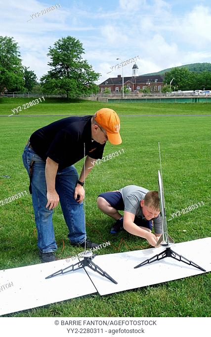 Teacher Instructing Student to Launch Model Rocket, Wellsville, New York, United States