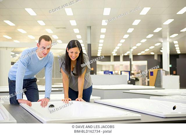 Couple shopping for bathtub in store