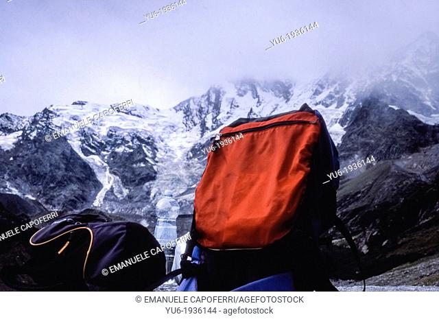 Red backpack, hike towards the east face of Monte Rosa, Macugnaga, Piedmont, Italy