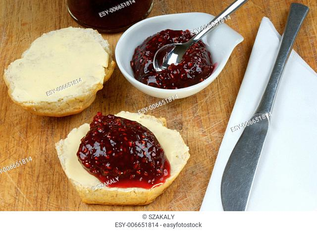 scone with organic jam on a timber board