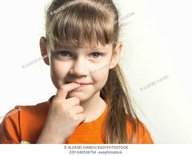 Portrait of a shy girl with finger in mouth on white background