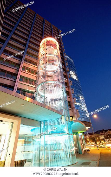 Modern office building skyscraper Vienna night