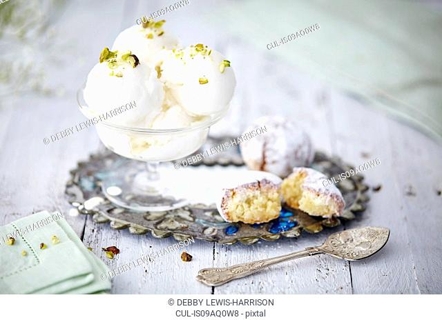 Still life of ice cream garnished with pistachio nuts