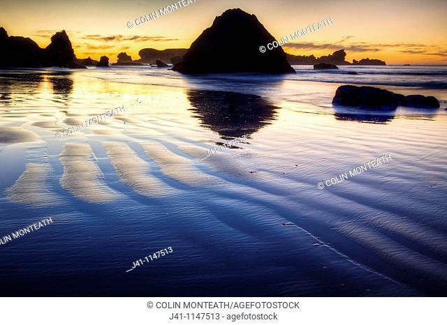 Sunset behind Seal Island, Woodpecker Bay, Paparoa National Park, West Coast