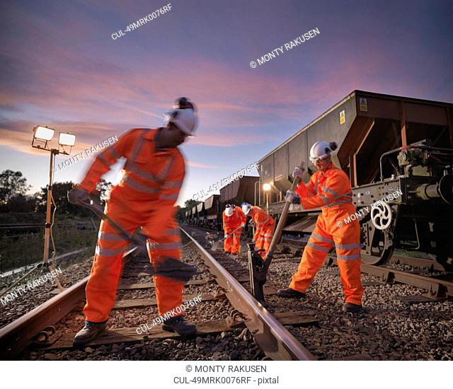 Railway worker adjusting train tracks