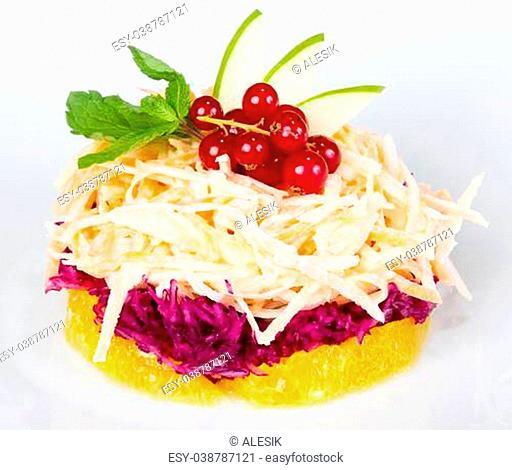 Fresh fruit and vegetables on a light dish, creative cuisine