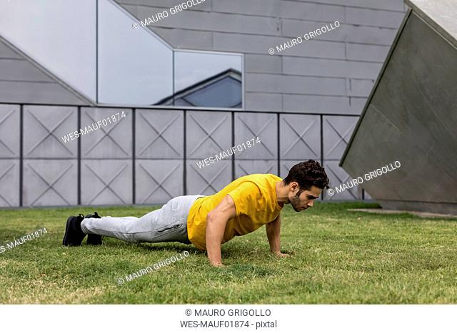 Young man during workout, pushup