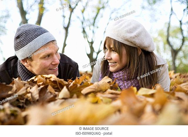 Couple lying on leaves