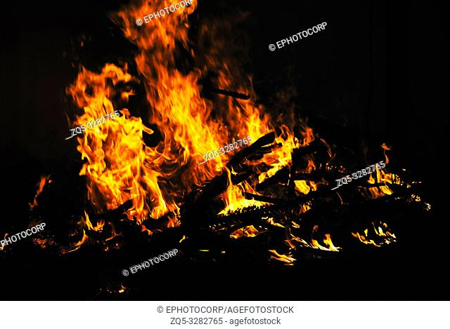 Bonfire with orange flames, Alibag, costal town, Maharashtra